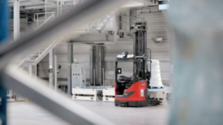 Automated R-MATIC reach trucks from Linde moving around the warehouse