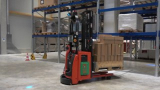 The L-MATIC HD automated pallet stacker from Linde Material Handling in use in the warehouse