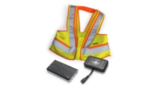 Interactive warning vest, wearable unit and truck unit