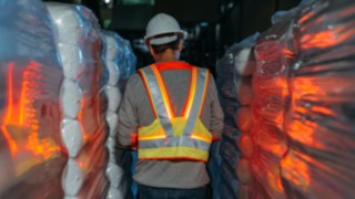 Interactive warning vest from Linde Material Handling glows in dark aisles