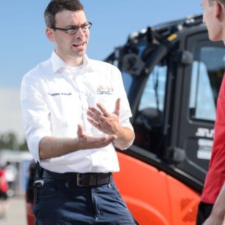Johannes Kratzel, Head of Event Support, in discussion with Formula Student volunteers